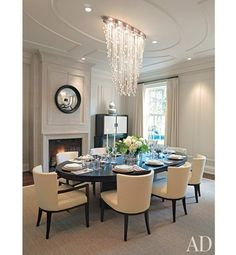 The jumping-off point for the dining room revamp was a light, affixed to the ceiling with a nickel plate, from which dozens of crystal strands in varying lengths, punctuated by crystal balls, fell like raindrops. The light inspired Powell & Bonnell to apply oval molding to the ceiling and design an oval dining table