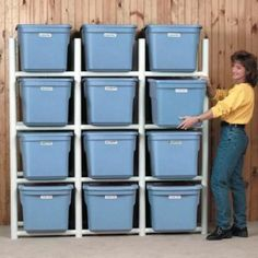 Garage organization! The pvc pipes keep them off the floor, and you can easily get to the bottom bin and not have to unpile the ones on top