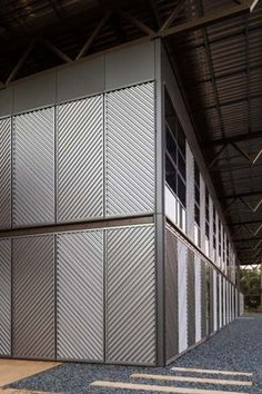 Charles Sturt University School of Dentistry. The pavilion walls are protected by LYSAGHT SPANDEK® profile cladding made from COLORBOND® Metallic steel in the colour Cortex®.