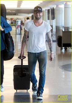 Adam Levine @ LAX. Wonder if he needs a ride home? :)