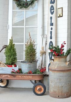 Vintage decor beautifully styled Christmas on the front porch. See how an old Greyhound wagon is used in this simple outdoor Christmas display!