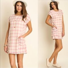 Pretty In Pink Plaid Dress Perfect for the spring time! Pink and cream mixed plaid with pocket detailing by the waist. The seam lines are slightly frayed to add some simple detailing. Made of a cotton and poly blend. Sizes S embellished Dresses
