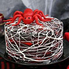 Red Velvet Marshmallow Spiderweb Cake—classic red velvet cake with black chocolate buttercream, covered with a web of marshmallow spiderwebs!