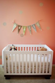 Subtle polka dot walls in baby girl nursery - #projectnursery