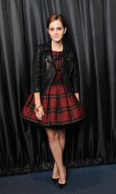 Emma downplayed the girlie factor and added a little punk to her look with a leather biker jacket.