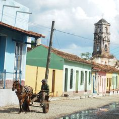 The town if Trinidad (Cuba) lies in a coma, where horse-carts drive up and down the cobblestone streets.