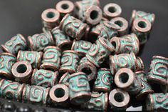 10 Mykonos Greek Casting Beads - Barrel Tube - Copper and Green Patina - 10 BEADS. $9.40, via Etsy.