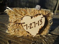 My save the date's. I bought the mini hay bale and wooden heart + wood burner from Michael's. Burned in our wedding date and took a photo on our back deck with my engagement ring on top. I'm hoping to have hay bales as seating at the reception.