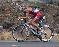 Chrissie Wellington ripping up the bike course, en route to her 4th Ironman World Championship title. Note evidence of her bike crash road rash. What you can't see is the fact that she had torn intercostal muscles too. What a warrior!