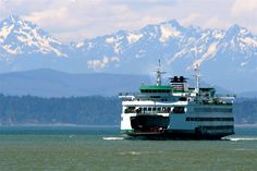 Ferry boat coming into Seattle with the Olympic Mountains in the background :)