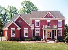 This Colonial two-story home combines a stately exterior style with a large, functional floor plan.  House Plan # 161094.