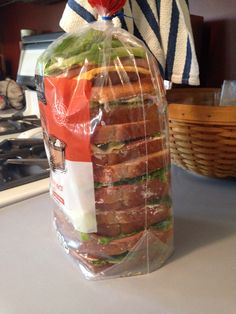 Need to pack a bunch of sandwiches for a long road trip? Save the plastic bread bag and store them in there. It saves on plastic baggies and keeps them in shape!