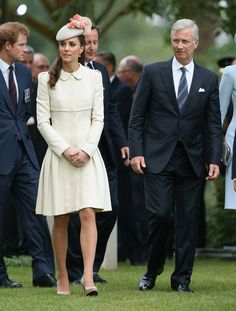 Kate Middleton - Catherine, Duchess of Cambridge walks with King Philippe of Belgium past war graves at St Symphorien Military Cemetery on August 4, 2014 in Mons, Belgium.