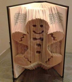 Create your own piece of stunning Book Art with this Gingerbread Man Combi Cut and Fold Book Folding Pattern. Download Today !!