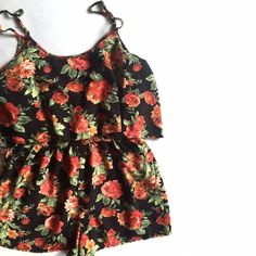 """Forever 21 Two- Tiered Floral Romper Who doesn't like a romper? You get all the fun of a tank top and shorts in one. Especially when it has a loose top, like this one. I put it on and couldn't take it off. It took a lot of convincing from my cat to finally do it. He always talks me down when I'm in crisis mode. Awesome bright floral detail. Good used condition. No noticeable flaws. Adjustable straps.   Length: 28"""" Bust: 36"""" Waist: elastic waist 26-38"""" Inseam: 2.4"""" Forever 21 Tops"""