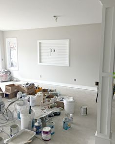 Lake house update - paint and trim updates in a new lake house build. Classic cottage style, board and batten, old barn beams.