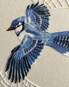 """cafeinevitable: """"Blue Jay by Alanna Hart hand embroidery """" When anyone asks what I mean by thread painting, I will forever show this photo now🖤 Embroidered Bird, Crewel Embroidery, Hand Embroidery Patterns, Ribbon Embroidery, Cross Stitch Embroidery, Machine Embroidery, Embroidery Letters, Cross Stitch Bird, Embroidery Designs"""