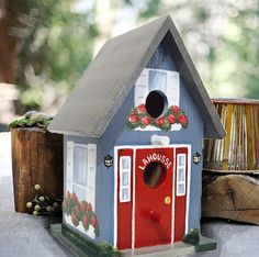 Item Description: This light-weight, hand painted birdhouse is a uniquely painted in a realistic home and garden style to match your home. Please contact me with a description or photos of the home you would like painted. Personal items and pets can be added as well. It stands