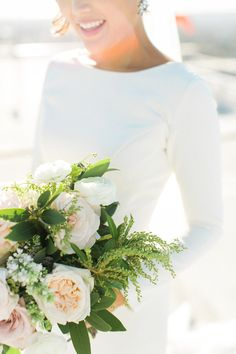Photography : Ruth Eileen Photography | Floral Design : Art With Nature | Wedding Dress : Atelier By Dawn Read More on SMP: http://www.stylemepretty.com/2016/01/21/downtown-l-a-wedding-with-rooftop-views/
