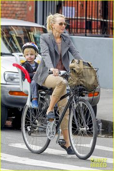Naomi Watts cycling around NYC with kids in tow.