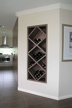 we've had an alcove built right next to our study nook to house a wine rack just like this shown in an  Eden Brae display home!