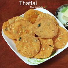 Thattai Thattai are South Indian crackers made with flour, spices and herbs. Learn to make the best crunchy & tasty thattai at home South Indian Snacks Recipes, Indian Dessert Recipes, South Indian Food, South Indian Breakfast Recipes, Indian Recipes, Pakora Recipes, Chaat Recipe, Paratha Recipes, Roti Recipe