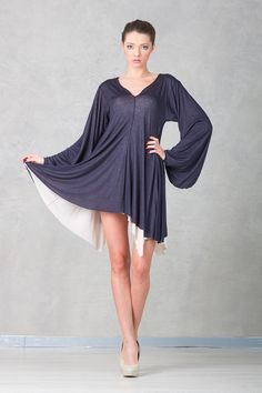 Robe Dress stands out with a special cut inspired by a unique medieval male wear.