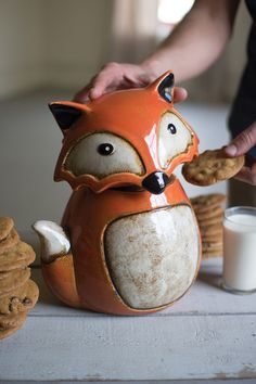"This adorable fox cookie jar makes the perfect kitchen companion. With bright colors and a gorgeous ceramic glaze, this sneaky little fella will store away your favorite baked goodies. 9½"" x 7½"" x 11""t"