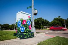 Artist Anat Ronen on Thursday painted a traffic control cabinet with spring colors on the corner of West Bellfort and Willowbend Boulevard. This is the first of many utility boxes she hopes to camouflage. Photo: Marie D. De Jesus, Staff / © 2015 Houston Chronicle Urban Street Art, Urban Art, Electric Box, Garden Mural, Painted Boxes, Street Art Graffiti, Learn To Paint, Street Artists, Spring Colors