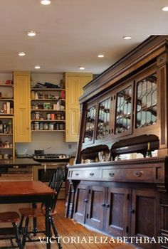 Planning our DIY kitchen remodel… I love the idea of using salvaged or repurposed materials in place of traditional kitchen cabinets.