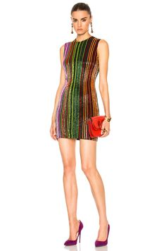 Multicolor embroidered dress. Sleeveless, close-fitting neckline, gold-tone zip-fastening through back