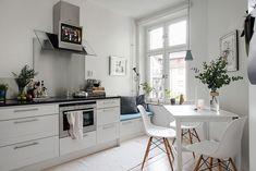 White kitchen with window seat