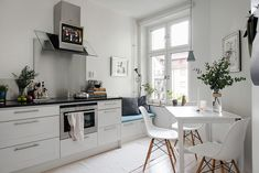 White kitchen with window seat