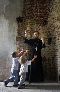 Priest Sergei Smirnov in one of the rural churches in Voronezh region. His sons come running at the sound of the church bells. As a schoolboy and a student of economics, Father Sergei often visited monasteries with his father. These trips, plus the contact he had with the monks, influenced Sergei's decision to enter the Voronezh Orthodox Theological Seminary after graduation. He is presently a member of the clergy of the Voronezh diocese.