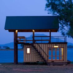 shipping container cabin - out on a beach somewhere with a BBQ kitchen up top and a cozy bed and bathroom below - all I need x