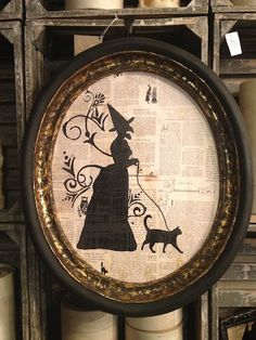 Great decoupage idea - witch and cat silhouette on book pages framed - so cute for Halloween decor!
