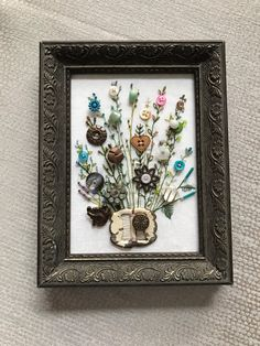 Send me your Antique or Family heirloom buttons and I will sew a custom picture for you. Your frame or mine the price will vary depending on frame and size. Write me to discuss details.