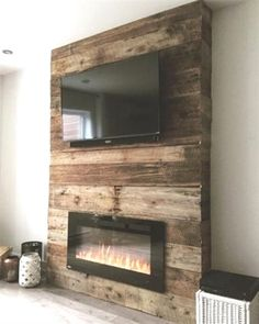 Diy Tv Stand With Electric Fireplace.Inspirations: Electric Fireplace Tv Stand Lowes For . Fireplace Accent Walls, Fireplace Tv Wall, Fireplace Design, Wall Tv, Pallet Fireplace, Fireplace Ideas, Fireplace Modern, Master Bedroom Wood Wall, Reclaimed Wood Fireplace