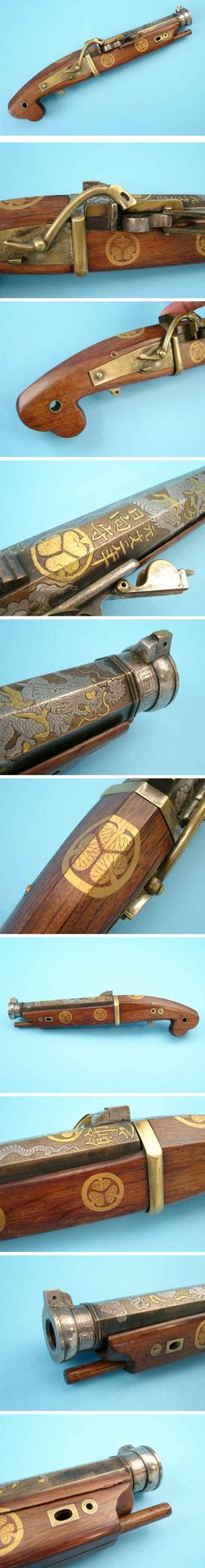 Japanese matchlock pistol, dated 1732, tapering octagonal bronze barrel decorated with damascened dragon in clouds over its full length, muzzle damacened in silver, standing sights damascened in gold and silver, fitted with damacened bronze pan, fence and pan cover, plain bronze lock with figured wooden full stock decorated with five gilt-lacquered Tokugawa mon, small plain bronze mounts and trigger and original wooden ramrod, with Tokugawa mon and three brief inscriptions, 13 5/8 in.