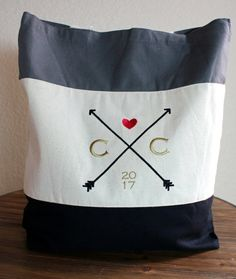"**These Bags are high quality and gorgeous! The designs are embroidered on the bag and NOT screen printed so they will not rub or chip off.       1 BAG  ~Dimensions: 15"" wide x 15"" tall x 3"" deep   ~You choose the bag color  ~You choose the initials  ~You choose the year  ~The thread colors stay the same. The arrows are black, the heart is red, and the initials and year are gold.     ____________________________________________________________________________________    HOW TO ORDER    1…"
