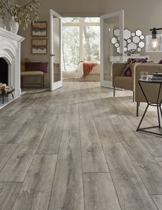 Hot Product Pick--Blacksmith Oak laminate, a sophisticated rustic look that evokes images of time-worn floors in French chateaus: http://www.mannington.com/Residential/Laminate/Restoration-Collection/Blacksmith-Oak/28300