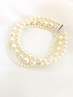This is the perfect 3 strand pearl bracelet. Three different styles of pearls, all strung together for a classic, beautiful look!   http://www.alichristinebridal.com/#!product-page/cv9c/a7bac836-d035-328c-d4dc-44ed1d479732  #pearlbracelet #weddingjewelry #bridaljewelry #weddingbracelet #bridalbracelet #ivorypearlbracelet
