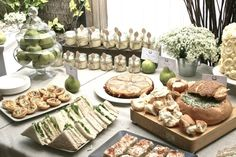 food table - rustic, wooden cutting board, apothecary jars, good presentation, white flowers, antique white