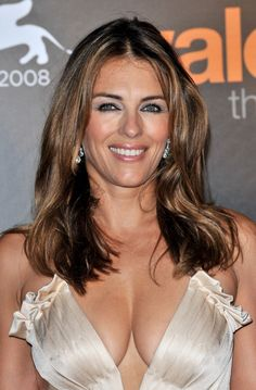 1fb0257e8f5f5 Elizabeth Hurley cleavage display at Venice Film Festival on August 2008