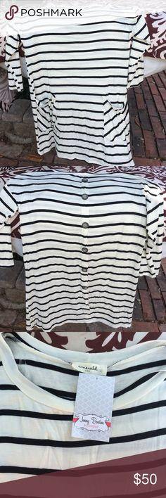 Cream and black striped top, brand new with tags! Buttons down the back and 3/4 length sleeves. Can be worn as a tunic with leggings. Emerald USA Tops Tunics