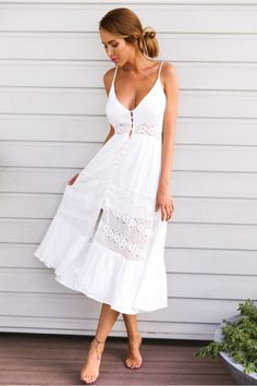 The Butter Cake Maxi Dress has a deep, v-neckline and button down front. Supported on thin, adjustable straps and a ruched waist. With decorative lace panels through the waist and skirt. Style yours with a pair of lace up gladiator sandals!  Dress. Partially lined. Cold hand wash only. Model is a standard XS and is wearing XS. True to size. Non stretchy fabric. Cotton/polyester.