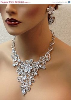 A personal favorite from my Etsy shop https://www.etsy.com/listing/231613265/bridal-jewlery-bridal-back-drop-bib