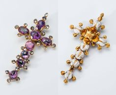 The cross...1500 AD Gold pendant cross set with rose-cut rubies bordered by rose-cut diamonds. The cross is enamelled white on the reverse. An applied flower is enamelled in translucent amber on the reverse; the front of the flower is enamelled in opaque white and acts as a foil for the central ruby. Part of the Cheapside Hoard