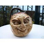 """VERY LARGE TWO-FACED JUG MARTIN BROS(?)  ONE SIDE DEPICTING A SMILING MAN.  THE OTHER SHOWING THE FACE OF A LEARING GENT.  HANDLE TO TOP.  7 1/4"""" HIGH x 67 1/4"""" WIDE x 6 7/8"""" DEEP.  BASE IMPRESSED - MARTIN Bc 52."""