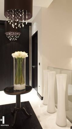 Tall exposing centre piece's evolve a whole room- Kelly Hoppen